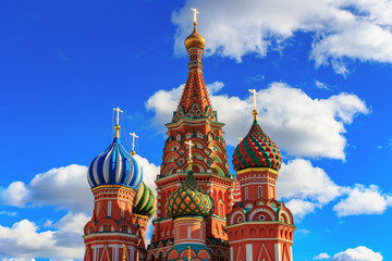 Domes of St. Basil's Cathedral on a background of blue sky with white clouds