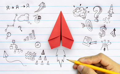 Business success, innovation and solution concept, Red paper plane and business strategy with hand drawing on notebook
