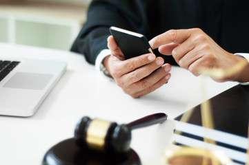 man searching law charter with smartphone in law firm.