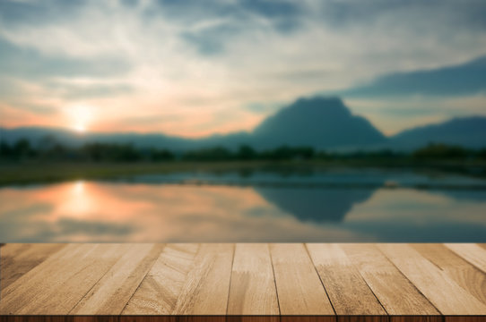 wood tabletop with blurred amazing landscape background.