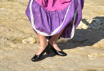 Close-up of a flamenco dancer's legs