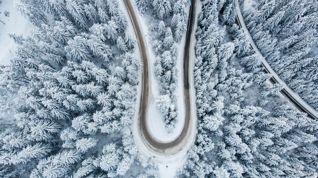 Overhead view of a winding road through a snowy forest, Bosnia and Herzegovina