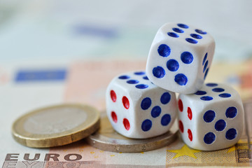 Dices on euro money background - Concept of risky investments and gamble