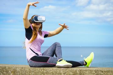 Woman wearing VR outside