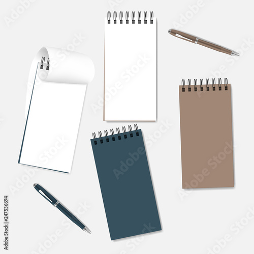 Spiral Notebooks With White Pages Colored Covers And Ballpoint Pens