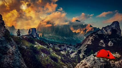 Great sunset bivouac view of the top Tofana di Rozes and Cinque Torri range in  Dolomites, South Tyrol. Location Cortina d'Ampezzo, Italy, Europe. Dramatical cloudy scene. Beauty of mountains world.