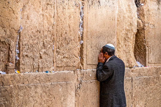 Believing Jew is praying near the wall of crying