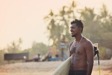 Portrait of surfer at sunset