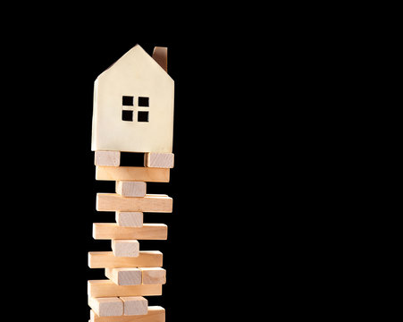 house standing on a unstable base concept of real estate invesetment