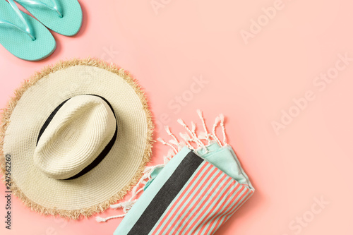 dc0e7f43 Female outfit for beach. Straw sunhat and beach slaps on punchy pink with space  for text. Summer tropical concept.