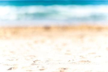 blurred summer background of the bright and warm beach of the ocean coast