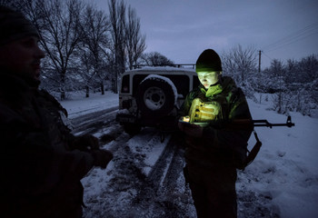 Ukrainian servicemen are seen in the government-held village of Travneve