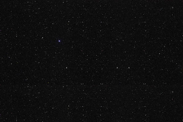 Black shiny mix of jewels texture background. Looks like starry night sky or space galaxy.