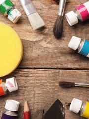 Painter utensils on wood