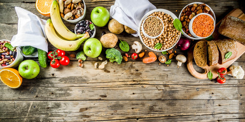 Healthy food. Selection of good carbohydrate sources, high fiber rich food. Low glycemic index diet. Fresh vegetables, fruits, cereals, legumes, nuts, greens.  copy space