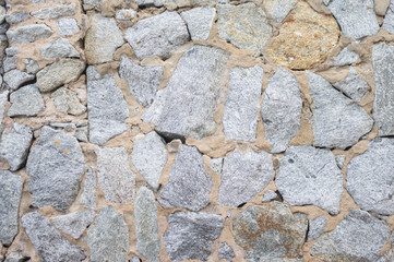 Stone rock pattern on wall, background.
