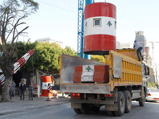 Cement barrier is seen in a truck in front of the Interior Ministry in Beirut