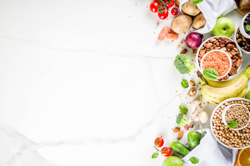 Fototapeta Healthy food. Selection of good carbohydrate sources, high fiber rich food. Low glycemic index diet. Fresh vegetables, fruits, cereals, legumes, nuts, greens.  copy space obraz