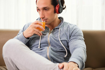 Man with juice resting at home