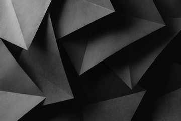 Triangular shapes of gray paper for dark astract background