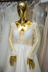 Wedding dress on a golden mannequin