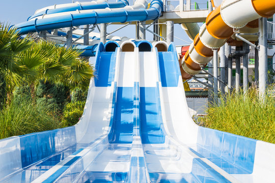 Adult water slides with pipes in water park.