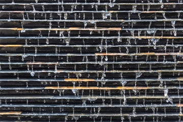Abstract Waterfall wall texture background. Waterfall on stone wall background.