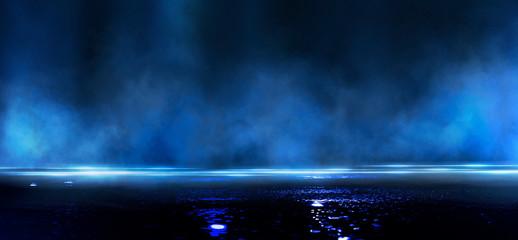 Wet asphalt, reflection of neon lights, a searchlight, smoke. Abstract light in a dark empty street...