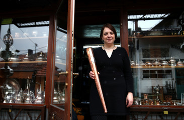 Nermina Alic, posing for photo with her designed the Olympic flame torches for the upcoming EYOF in Sarajevo