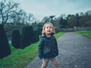 Little toddler in a formal garden