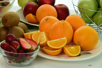 Orange and cut fruit Beautifully placed on the plate