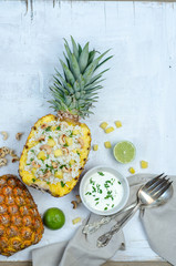 Homemade rice with cashew in pineapple.