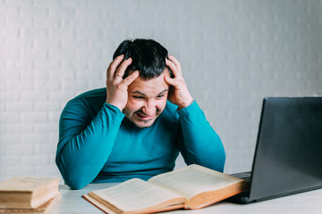 Man reading a book and nervous screams can't remember