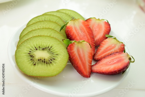 Fresh red strawberries and kiwifruit cut Beautifully placed