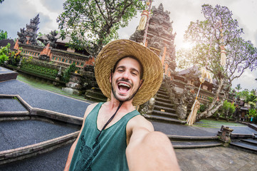 Excited man taking a selfie on a trip in Bali