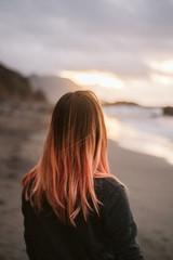 Anonymous woman standing near sea