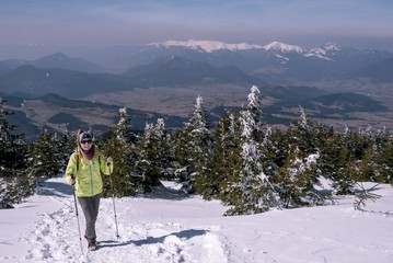 Smiling tourist on winter mountain, beautiful panorama with alps
