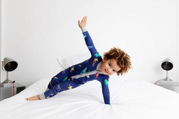 Boy in side plank position