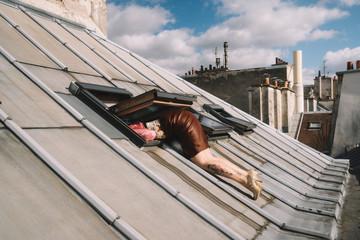 Woman climbs in skylight