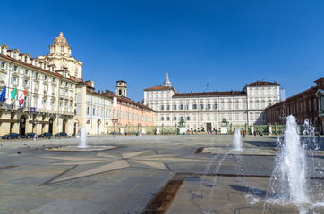 Royal Palace Palazzo Reale and San Lorenzo church building on Castle Square Piazza Castello with fountains and monuments in historical centre of Turin Torino city with clear blue sky, Piedmont, Italy
