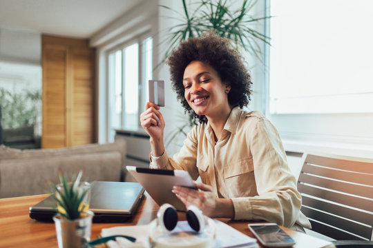 African american woman with tablet and credit card