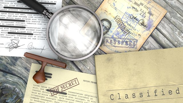 Top secret document, declassified, confidential information, secret text. Non-public information. Sheet of paper with classified information. Rubber stamp and magnifying glass. Passport, secret agent