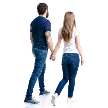 Man and woman hold hands goes on white background isolation, back view