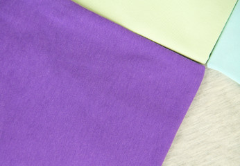 background with purple, blue, green and gray textiles