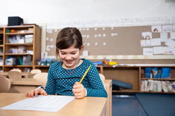 Girl smiling while taking test
