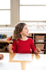 Side view of girl in classroom