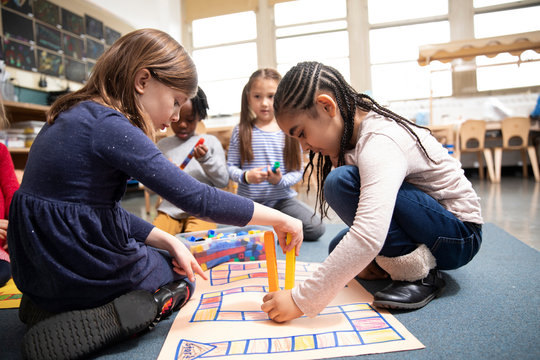 Students playing math game with plastic blocks