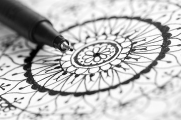 Mandala doodle hand drawing with pen, black and white