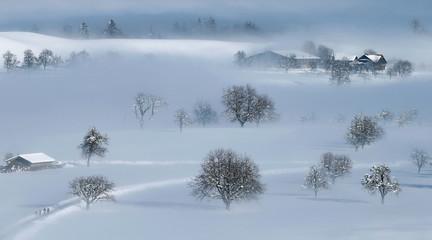 The snow-covered landscape is seen near Menzingen