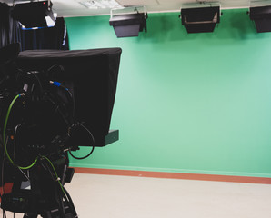 studio and camera, green background
